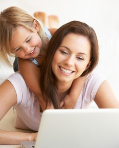 mom-working-from-home-with-happy-daughter-vert